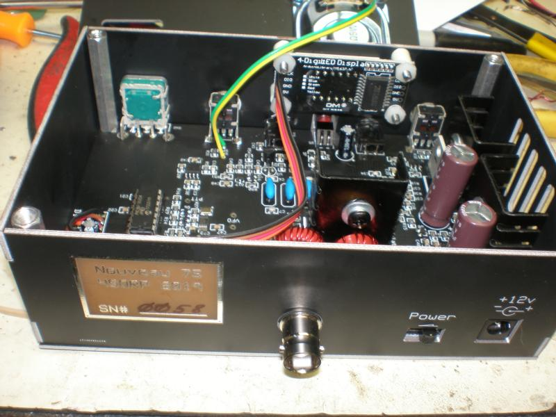 Enclosure is made of black-masked PCB material.  Speaker and display shown