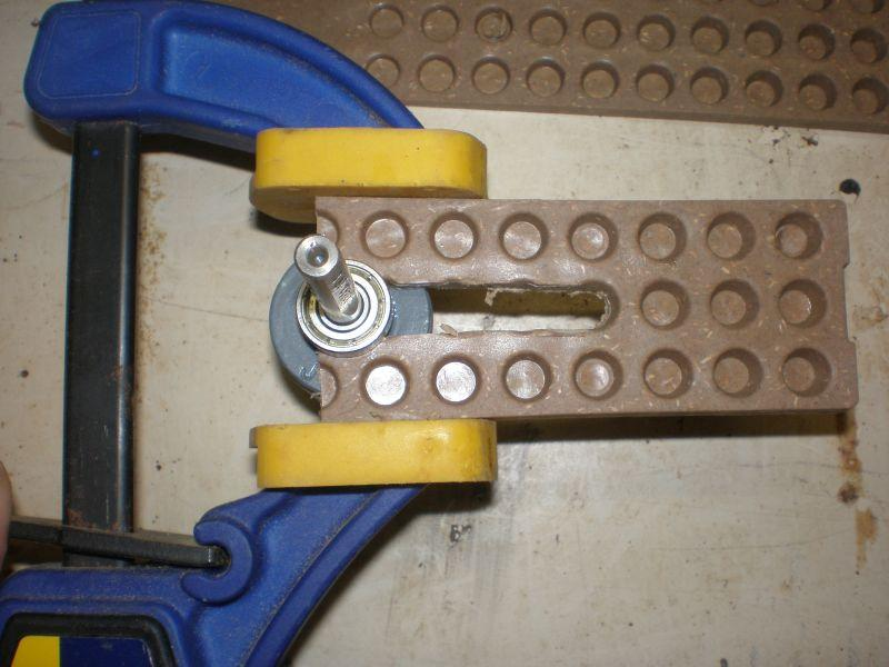 Snug up woodworking clamp to prevent wedge from spreading to the side