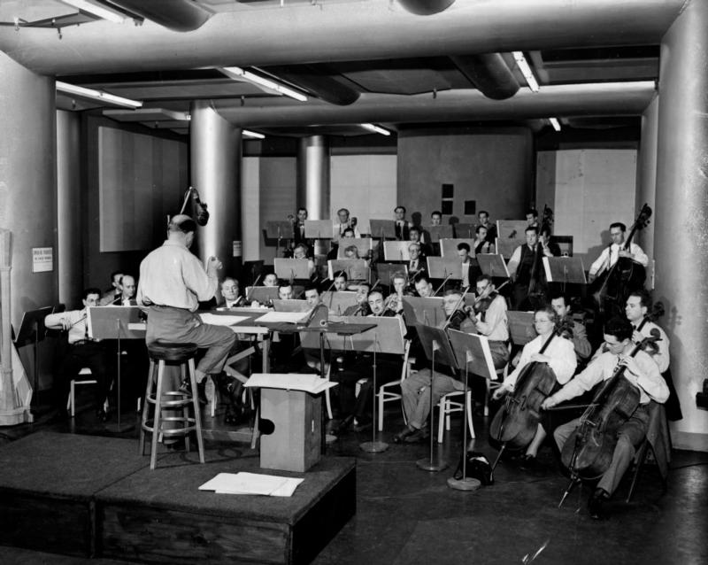 Eugene Ormandy conducting music for